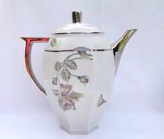 Art Deco Limoges porcelain coffee set by Robert Haviland and Le Tanneur, 1930s, coffee pot, creamer and covered sugar bowl. This beautiful set was made in the 1930s and has an Art Deco style to it. There is a rose pattern and heavy silver gilding. The coffee pot, creamer and covered sugar pot are all clearly marked on the bottom Limoges, France and the creamer and sugar bowl also have the crescent marked Robert Haviland & Le Tanneur. The set is made from fine porcelain.    The coffee pot ...