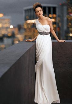 #DBBridalStyle his Grecian-inspired gown offers gorgeous draping and long, flowing lines. It's the perfect balance of softness and structure; boning and construction provide shape while silky charmeuse lining makes it a dream to wear.  White by Vera Wang, exclusively at David's Bridal Style VW351000