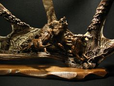 'Wild Boar and Laikas,' by Dmitry Gorodetsky (carved and stained moose antler and wood - 60cm x 32cm)