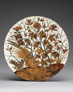 Tazza, made Paris 1880 The marquetry is executed in the distinctive technique patented in 1874 by Pierre- Ferdinand Duvinage (1813-1876). Duvinage had taken over the distinguished firm of Maison Giroux in 1867, and following his death his widow Rosalie ran the firm. The very distinctive wares executed in 'Duvinage' marquetry were produced from c.1874 to c.1882.
