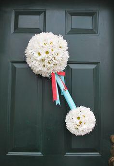 Flower Rattle-Supplies: 8-10″ half-moon floral foam, 3″ floral foam ball, empty paper towel roll, 2 colors of ribbon. 3-4 dozen daisies