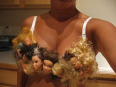 """Next up, in """"Things That Make You Go 'Ugh'"""" news: here's a bra decorated in Barbie doll heads. The unusual brassiere is made by artist Sarah Bellum of Etsy Barbie Doll Head, Lisa Phillips, Bras Best, Grunge, People Of Walmart, Incredible Gifts, Creepy Cute, Scary Scary, Creepy Dolls"""