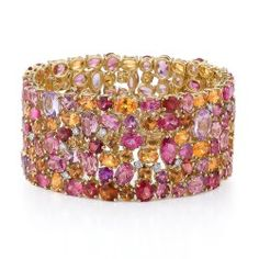 Sienna Cuff - Inspired by the works of the Renaissance Masters, the Sienna cuff reincarnates the spirit of creativity and adornment. Magnificent sunset hues of multi-shaped Mandarin Garnet