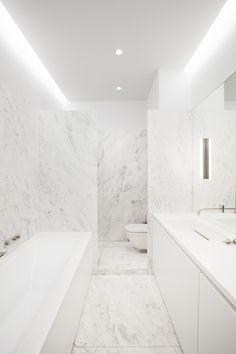 BATHROOM | CEILING | PHILIPP MAINZER: HOUSE H. marble slab bathroom white on white rebated strip lighting