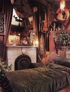 Something about this boho/gypsy bedroom has me falling in love...