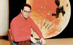Paterson Ewen photographed with Gibbous Moon, 1980, at an exhibition of his work organized by the Art Gallery of Ontario, Toronto, in 1988, photograph by Doug Griffin. Ewen's orange shirt matches the dominant hue of this moon, which seems to identify the artist even more intimately with this work. #ArtCanInstitute #CanadianArt Art Gallery Of Ontario, Canadian Artists, Printmaking, Landscape Paintings, Book Art, Orange Shirt, Hue, Toronto, Photograph