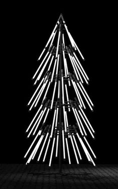 Gareth Pugh has created a Christmas Tree installation for the Topshop Oxford Circus flagship store. Using 60 neon bulbs, the tree stands three meters tall.