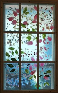 "Flower ""stained glass"" with fresh flowers and contact paper.  Perfect for the play room's french door!  Would also be nice with colored leaves in the fall."