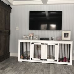 This room is perfect! Look at that beautiful rustic barn door! Love how pet furniture can fit in with your home decor!