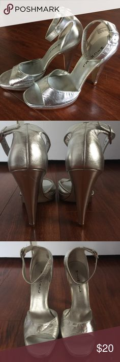 Michael Nissa Silver Heels Size 8.5 Genuine leather silver 4 3/4 inch heels. Never worn. Some slight scratches on heels as shown in photos. Not noticeable when worn. Michael Shoes Heels