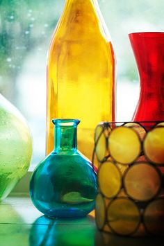 Pretty rainbow colored vases in the window