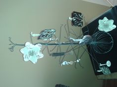 junky decorative ornaments (tin, numbers and an old necklace) on a wire tree
