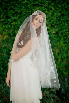 Had this veil customized with more flowers in the Chapel length for my gown! I can't wait to see what it looks like together =)