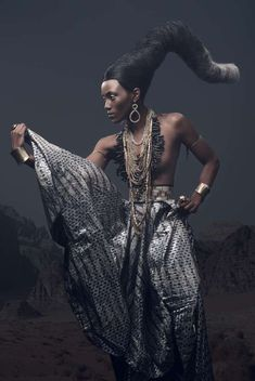 Harper's Bazaar meets tribal. Darkened metallics and dulled grey silvers. Accentuated pieces combined with the basic layered jewellery.