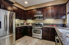 Upgraded with granite countertops, travertine tile, and stainless steel appliances in this gorgeous Entertainer's Kitchen. Home located in Aliso Viejo California