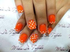 White Polka Dots and Orange Nails