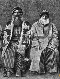 Two 'dede' (religious leaders) of the Kızılbaş (Alevi Kurds from the Dersim region), wearing formal/ceremonial outfit, in 1937. Ethnic group: Zaza. The Dersim region contains the actual Tunceli province, and some neighbouring districts of the Elazığ and Bingöl provinces.