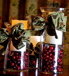 Hurricane Vase Christmas centerpiece using cranberries and elegant ribbon