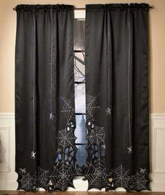 This like it could be a fun and fairly simple diy with some cheap black curtains, scissors, and silver fabric paint.