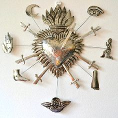 Corazon con espadas y milagritos. Pierced sacred heart with miracles. $50 in stock now ( jun 2012) in Australia