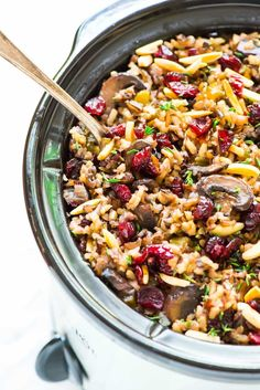 Crock Pot Stuffing with Wild Rice, Cranberries, and Almonds. An easy, DELICIOUS gluten free stuffing recipe everyone can enjoy!