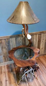 Custom antler lighting, including table lamps and floor lamps.