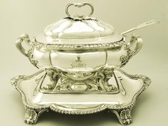 The soup tureen is presented with associated fiddle and thread patterned ladle with matching bright cut engraved crest. The ladle was made by 'William Chawner II, London' in 1831.  This George IV tureen is an exceptional example of its type - it is difficult to find pieces such as this presented with a matching stand.
