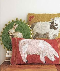 Hooked rug farm pillows.