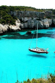 Turquoise Sea, Sardinia, Italy. Water is so clear it looks like the boat is floating in the air.