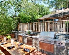 awesome backyard kitchen! perfect for my grill master :)