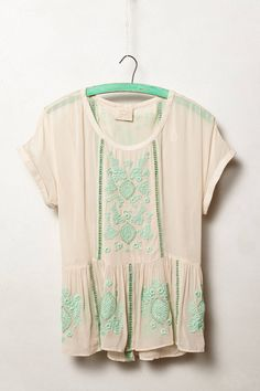 Summer top, mint green stitching. Super cute with darkish jeans