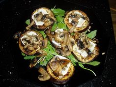 Eggplants, chevre and mushrooms on rucola-bed.