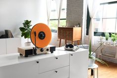This great take on an old classic holds records upright as they spin, giving the illusion they're suspended in air. The built-in full-range stereo speakers play high-quality sound, but you can also connect the player to external speakers via an RVA line out. Choose between a maple and a dark walnut base. Floating Record Vertical Turntable at https://www.kickstarter.com/projects/gramovox/floating-recordtm-vertical-turntable?ref=category