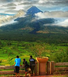 Enjoying the view, Mayon Volcano, Philippines (by marbleplaty).