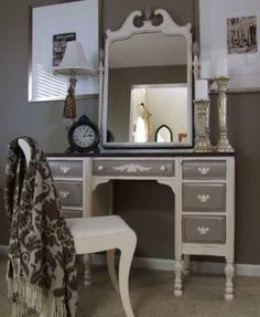 Selling this vintage ladies desk/vanity...refinished in tones of cream and french linen, with a stained walnut top and ivory hardware. The drawers are lined, and includes a mirror which sits on top...
