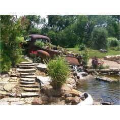 Old truck waterfall.this is a man's garden! :)  Great idea