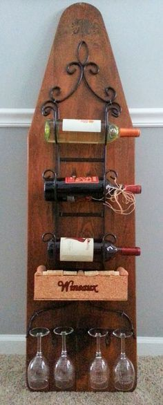 Wine bar...old wood ironing board...and a rake to hold the stems of wine glasses.
