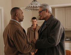 Stern Greeting Ziva (Cote de Pablo, center) is taken aback by the sudden emotional visit by her father, (Michael Nouri, right) who she hasn'...