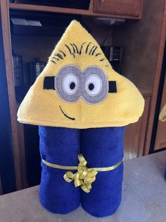 This listing is for beautiful inspired by Minion hooded towel. Made with a soft snuggle towel of high quality and great absorber. Towel is