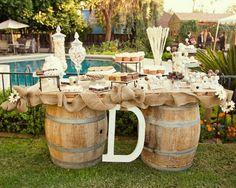 rustic wedding suitcase dessert bar | Rustic dessert table. LOVE the barrels