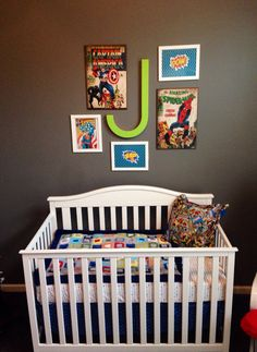 "Superhero Nursery- ottoman, bedding, and crib from Target; large wooden comic strip art from Hobby Lobby and Ross; framed printable ""Pow"" and ""zap"" free printables mounted on wrapping paper and framed; pillows made from vintage superhero fabric from JoAnn's fabrics"