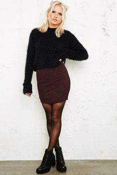 Black furry sweater, dark red skirt and black tights