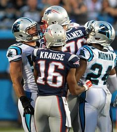 Carolina Panthers linebacker Luke Kuechly, left, gets helmet to helmet with New England Patriots tackle Sebastian Vollmer, center, following a play during action at Bank of America Stadium in Charlotte, NC on Friday, August 28, 2015.