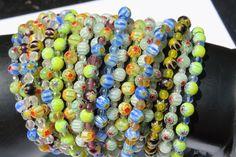 Assorted lot of 6mm millefiori bracelets  Average female wrist size.  Total of…