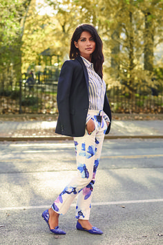 We love a good patterned pant, and our white, blue and purple painted floral pants are definitely at the top of the list this spring. Style these leg-lengthening Ryan pants with a vertical stripe button down, navy blazer and bold blue flats for a chic office look | Banana Republic