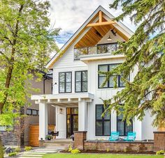 Modern farmhouse. Stunning curb appeal. White house and wood accent