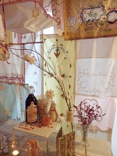 Curtain made with bits of vintage lace, napkins, handkerchiefs - very sweet