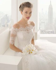 Off the shoulder wedding dress by Rosa Clara