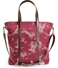 Made with a durable canvas exterior adorned in a soaring eagle and bird print, this large size tote bag offers ample storage space and comes equip with a removable crossbody strap.