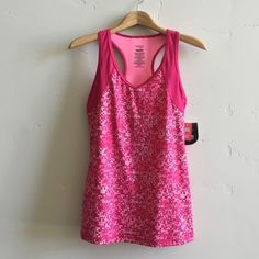 | NWT Danskin Workout Top Brand new with tags shades of pink dri-more razorback top with inner bra.  In new condition. Danskin Tops Tank Tops